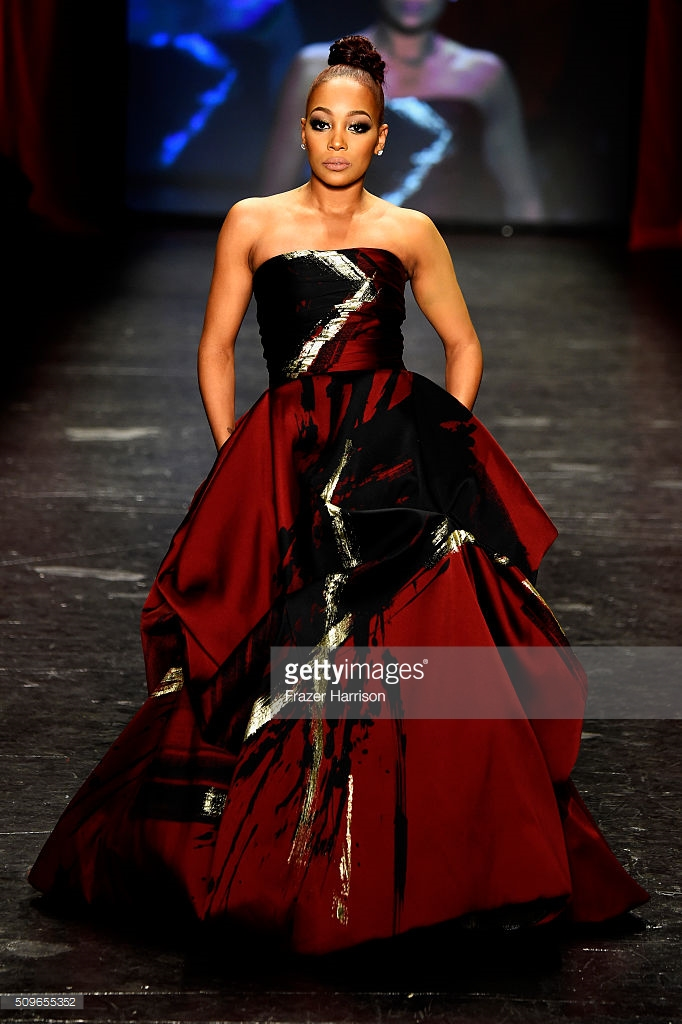walks the runway at The American Heart Association's Go Red For Women Red Dress Collection 2016 Presented By Macy's at The Arc, Skylight at Moynihan Station on February 11, 2016 in New York City.