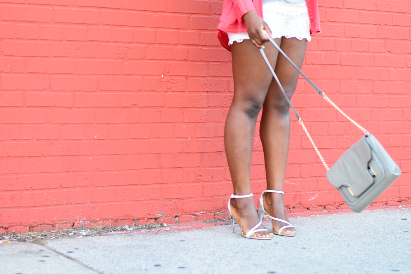 Befitting Style Oyinkan Wearing Orange Button Down- Crochet Shorts- White Sandal Heels